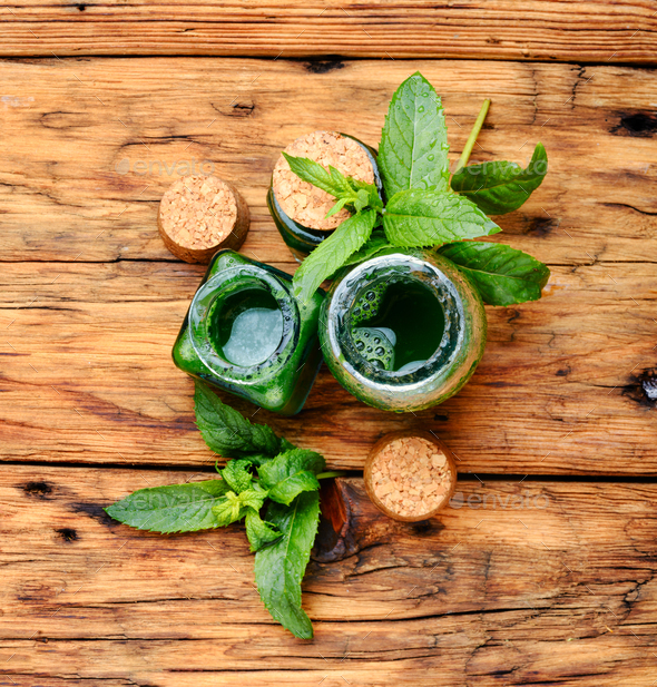Natural mint essential oil - Stock Photo - Images