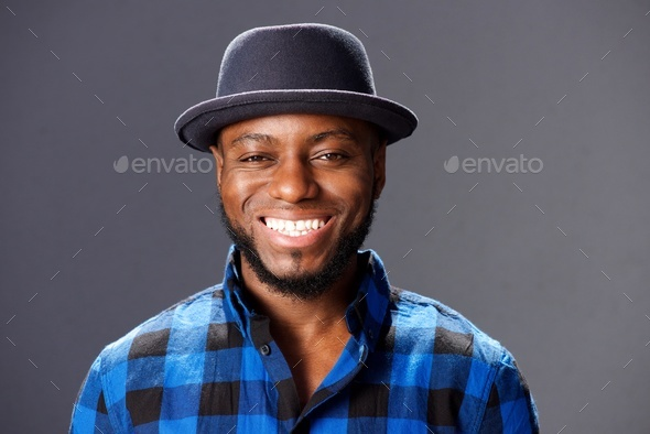 african man smiling with hat and plaid shirt - Stock Photo - Images