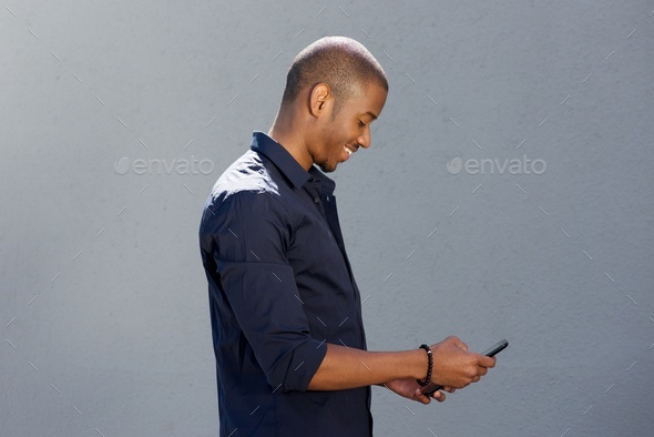happy african man holding cell phone - Stock Photo - Images