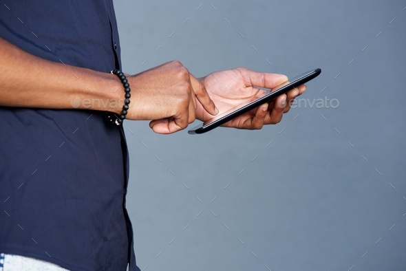 african man hands holding tablet - Stock Photo - Images