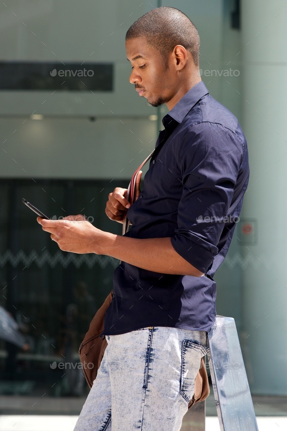 african male student standing outside with tablet - Stock Photo - Images