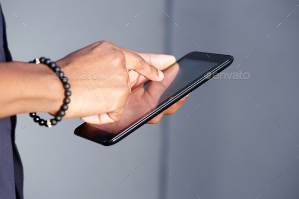 young black man hands using digital tablet - Stock Photo - Images