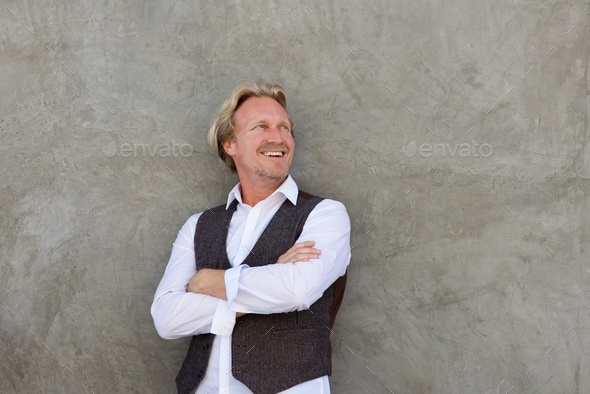 handsome middle aged man smiling and looking away - Stock Photo - Images