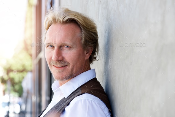 Close up portrait of handsome middle aged caucasian man - Stock Photo - Images