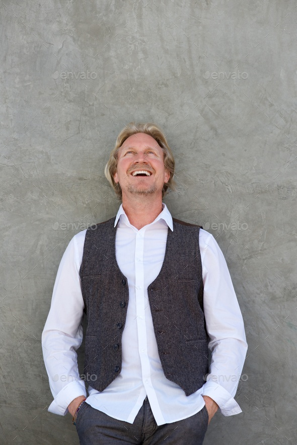 happy middle aged man laughing and looking up - Stock Photo - Images