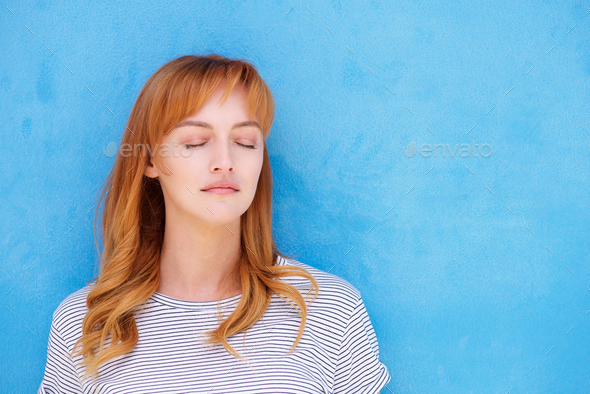 Young red hair woman with eyes closed - Stock Photo - Images