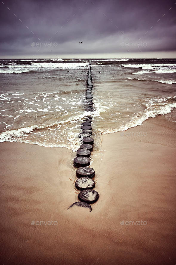 Vintage toned picture of an old wooden breakwater. - Stock Photo - Images