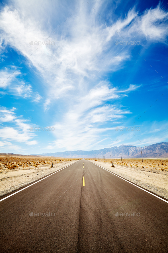 Endless desert road in the Death Valley, USA. - Stock Photo - Images