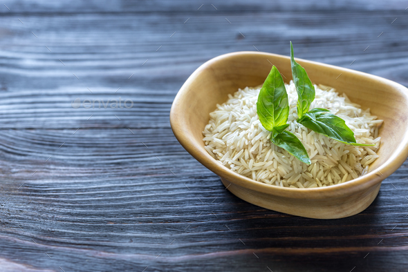 Bowl of uncooked basmati rice - Stock Photo - Images