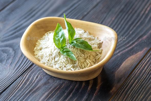 Bowl of uncooked basmati rice - Stock Photo - Images