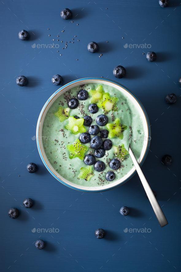 healthy spirulina smoothie bowl with blueberry, kiwi stars, chia - Stock Photo - Images
