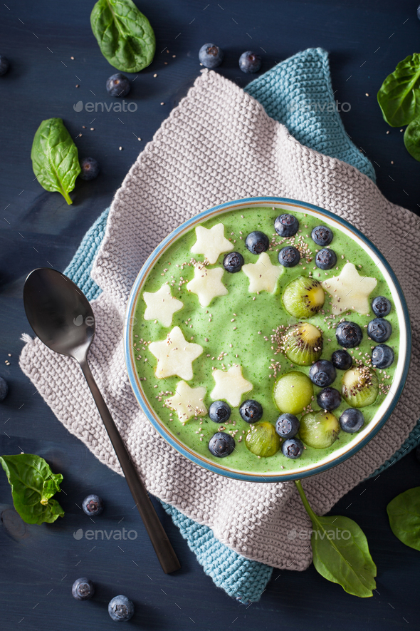 healthy green spinach smoothie bowl with blueberry, banana stars - Stock Photo - Images