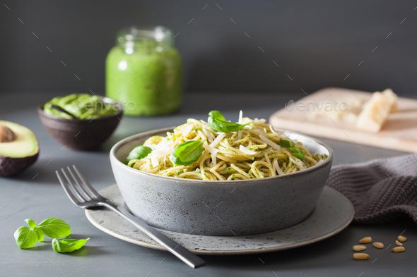 spaghetti pasta with avocado basil pesto sauce - Stock Photo - Images