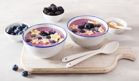 healthy berry smoothie bowl with banana and sesame seed - Stock Photo - Images
