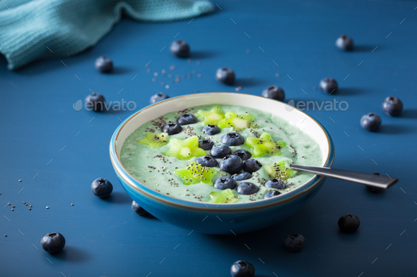 healthy spirulina smoothie bowl with blueberry, kiwi stars, chia - Stock Photo - Images