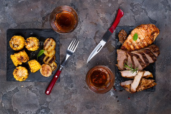 Fresh three types of grilled steak  on slate plate with herbs, juice and grilled potatoes - Stock Photo - Images
