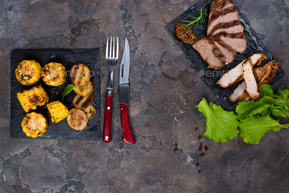 Fresh three types of grilled steak  on slate plate with herbs - Stock Photo - Images