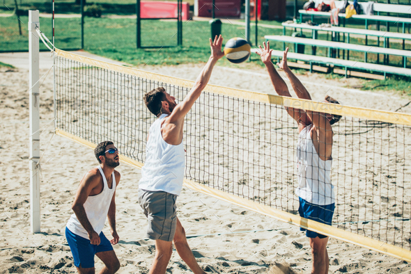 Beach volleyball detail - Males on the net - Stock Photo - Images