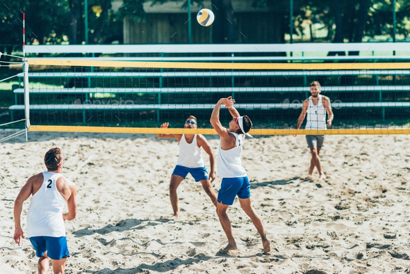 Beach Volleyball Players during Game - Stock Photo - Images