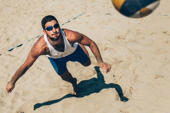 Beach volleyball Player about to hit the ball - Stock Photo - Images