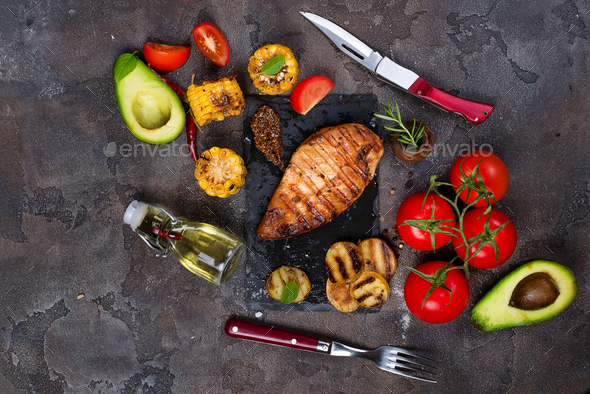 grilled healthy chicken breasts cooked on BBQ and served with fresh tomato, - Stock Photo - Images