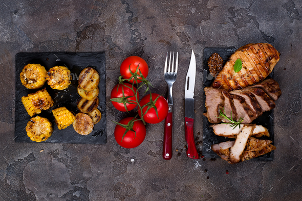 three types of grilled steak  on slate plate with herbs, corn, tomato - Stock Photo - Images