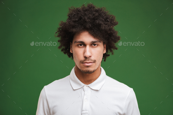 Handsome serious young curly man - Stock Photo - Images