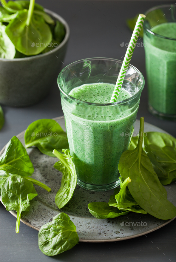 green spinach smoothie with spirulina, chia seed, lime, apple - Stock Photo - Images