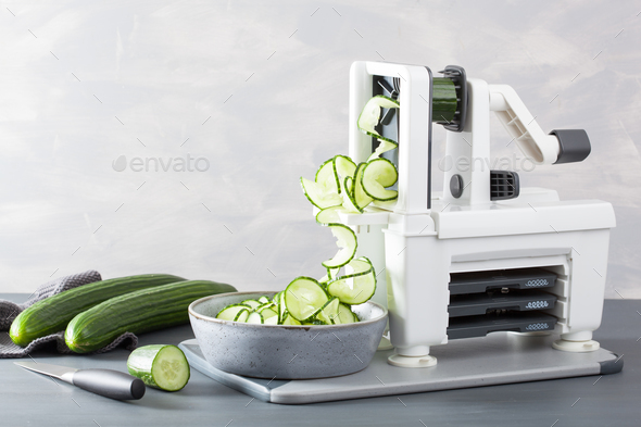 spiralizing cucumber vegetable with spiralizer - Stock Photo - Images
