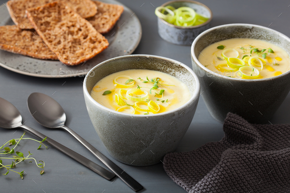 creamy potato and leek soup in bowl - Stock Photo - Images