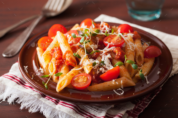 veggie penne pasta with tomatoes parmesan thyme - Stock Photo - Images