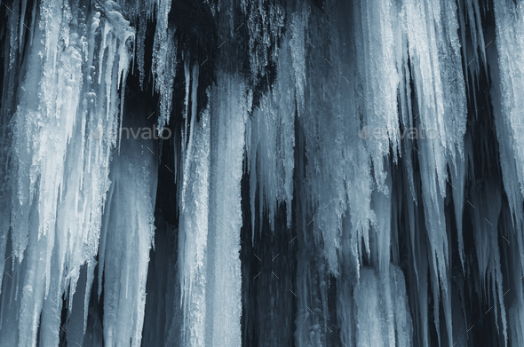 Frozen waterfall in cold winter ice background - Stock Photo - Images