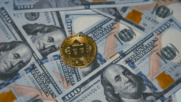 Golden Bitcoin Revolving On Bills Of 100 Dollars Stock Footage