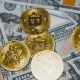 Golden and Silver Bitcoins Revolving on Bills of 100 Dollars. - VideoHive Item for Sale