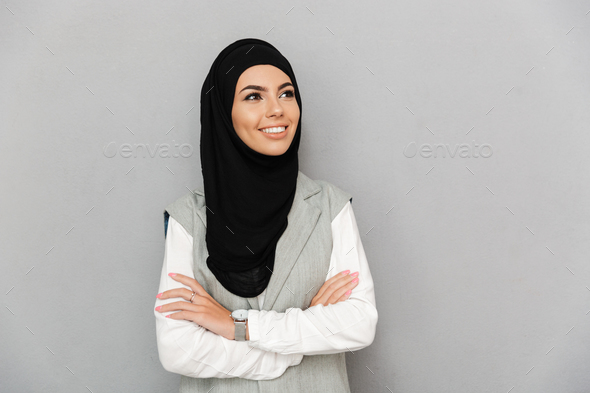 Portrait of muslim woman 20s in traditional scarf smiling and lo - Stock Photo - Images