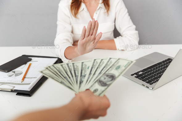 Close up portrait of hand holding cash - Stock Photo - Images