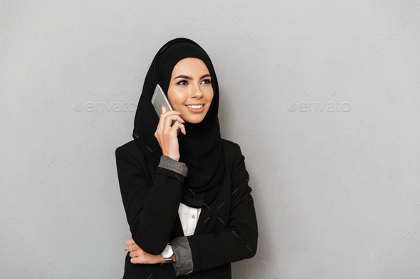 Portrait of a smiling young arabian woman - Stock Photo - Images