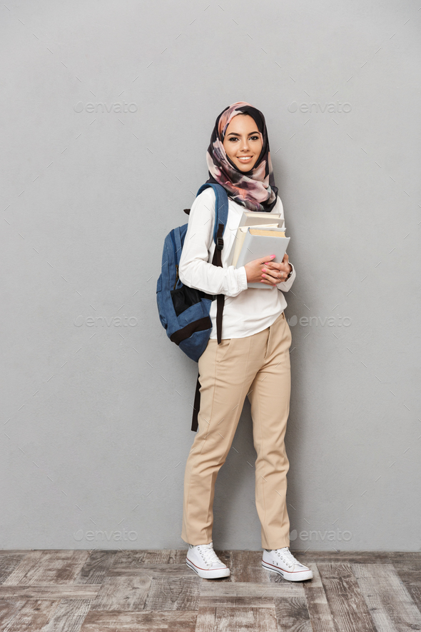 Full length portrait of a smiling young arabian woman - Stock Photo - Images