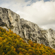 Mountain peak with colorful autumn trees and cloudy sky - PhotoDune Item for Sale