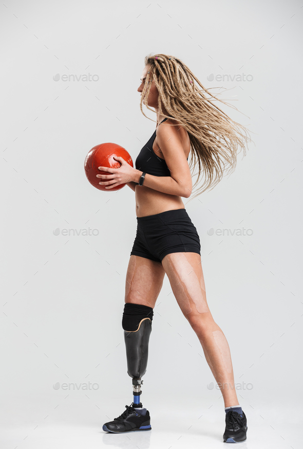Disabled sportswoman isolated make exercises with ball. - Stock Photo - Images