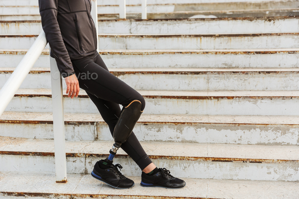 Cropped image of disabled sportswoman with prosthetic leg in tra - Stock Photo - Images