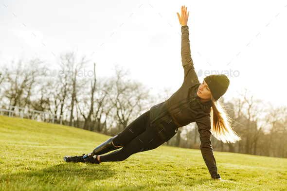 Image of sporty handicapped woman in black tracksuit, exercising - Stock Photo - Images