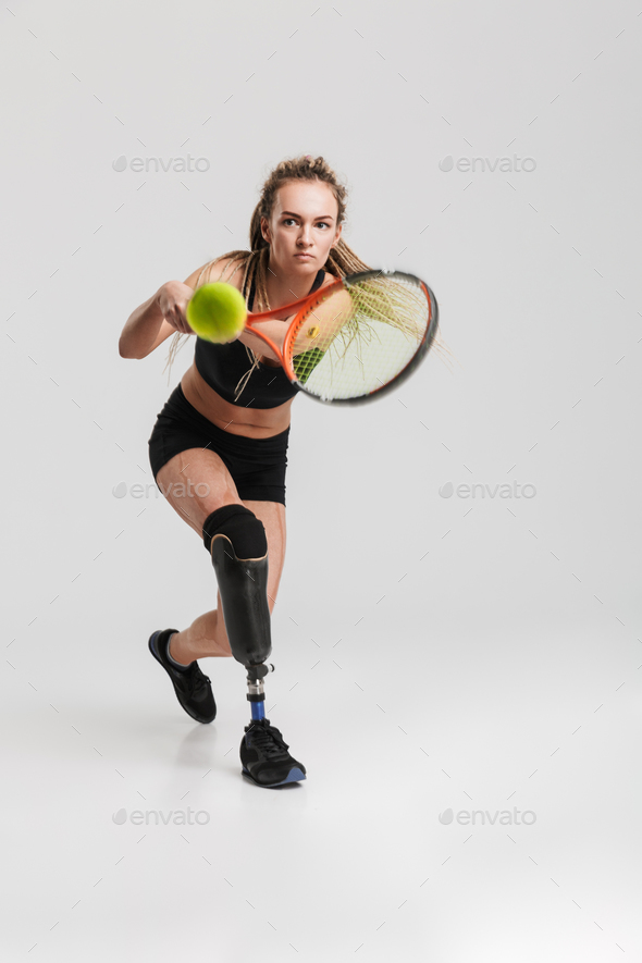 Strong young disabled sportswoman tennis player - Stock Photo - Images