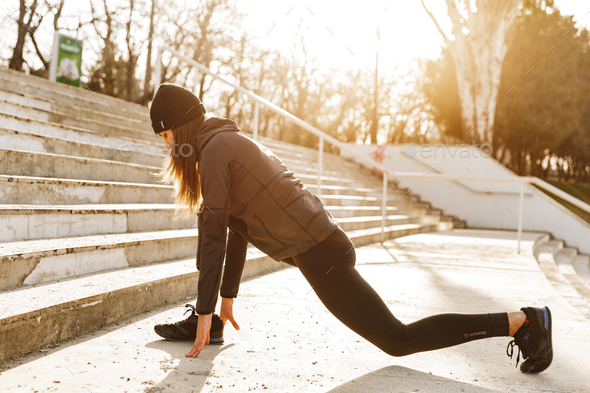 Image of disabled athletic girl in sportswear, exercising and st - Stock Photo - Images