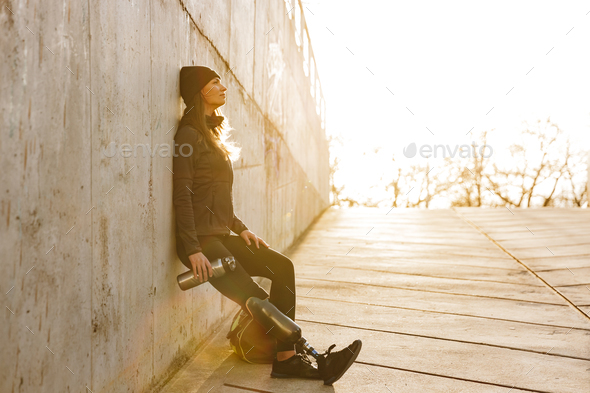 Photo of athletic disabled girl with bionic leg in sportswear, s - Stock Photo - Images