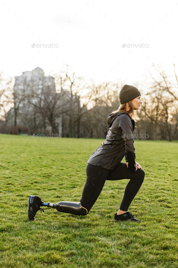 Image of disabled athletic girl in sportswear, doing sports and - Stock Photo - Images