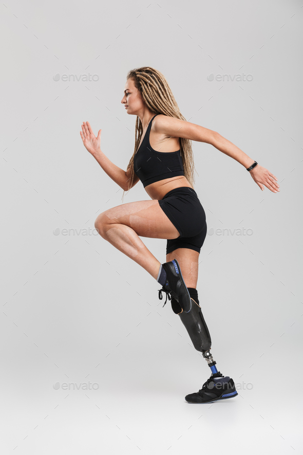 Amazing healthy young disabled sportswoman make exercises. - Stock Photo - Images
