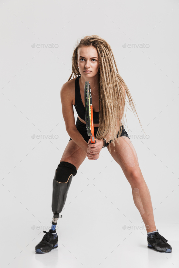 Healthy young disabled sportswoman tennis player - Stock Photo - Images