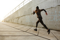 Portrait of disabled athlete woman with prosthetic leg in tracks - PhotoDune Item for Sale