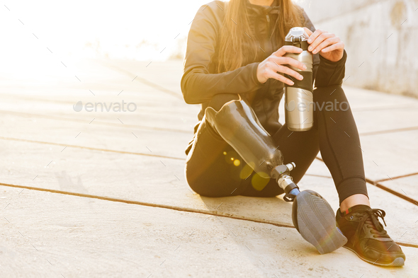 Cropped photo of athletic disabled girl with prosthetic leg in s - Stock Photo - Images